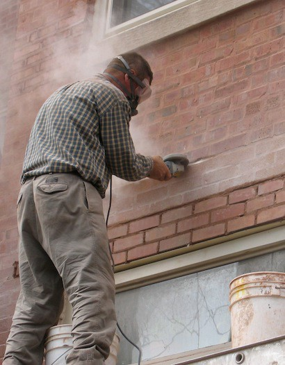 Mortar removal and replacement on a brick building
